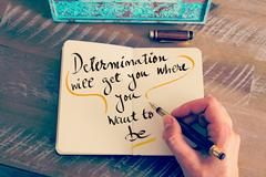 Handwritten text Determination Will Get You Where You Want To Be - stock photo