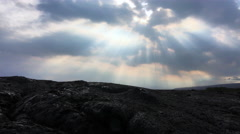 Colorful rays of sunlight over black lava field (4K) Stock Footage