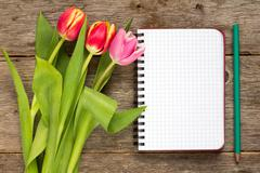 Stock Photo of Tulip bouquet and blank notebook