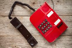 Vintage red phone on rustic  boards. Stock Photos