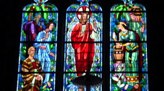 Religious transition, stained glass window on black background - panoramic, loop - stock footage
