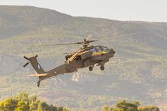 Apache helicopter taking off at the Athens air week flying show. Kuvituskuvat