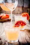 Non-alcoholic blood orange cocktail in glass Stock Photos