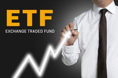 Stock Photo of etf trader draws market price on touchscreen