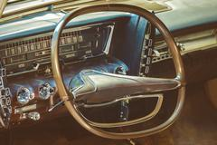 Dashboard of a classic car - stock photo