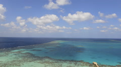 Time lapse of tropical coral reef and clouds - Sanganeb reef, Red Sea, Sudan - stock footage