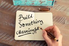 Handwritten text Build Something Meaningful - stock photo