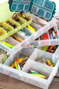 ishing lures and baits in plastic box - stock photo