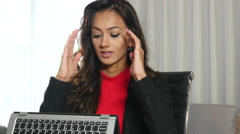 Unhappy sad ethnic businesswoman working on laptop tablet computer - stock footage