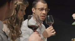 Young adults tasting wine - stock footage