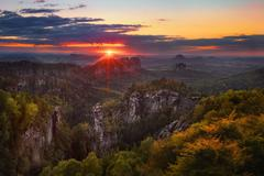 sunset view on Schrammsteine from Carolafelsen, Saxon Switzerland - stock photo