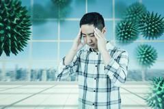 Composite image of asian man getting a headache Stock Photos