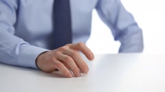 Businessman sitting at the table and tapping his fingers Stock Footage