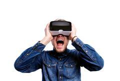 Man wearing virtual reality goggles. Studio shot, white backgrou Stock Photos