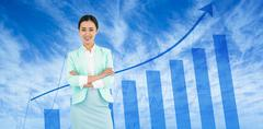 Composite image of elegant businesswoman with crossed arms Stock Photos