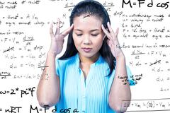 Composite image of worried businesswoman holding her head - stock photo