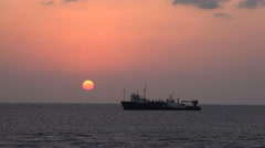 Boat floating at tropical sunset in the open sea. Weapon smuggler ship - Sudan Stock Footage