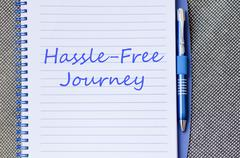Hassle free journey write on notebook - stock photo