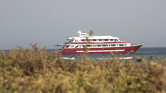 Luxury boat parking at sea. Foreground dry grass and plants - Red Sea Stock Footage