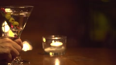 Man receiving a glass of martini at bar counter Stock Footage