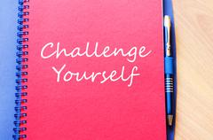 Challenge yourself write on notebook - stock photo