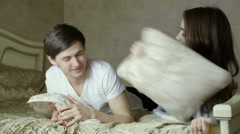 Wonderful couple fooling around. Bute pillows, having fun. Stock Footage