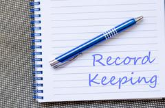 Record keeping write on notebook - stock photo