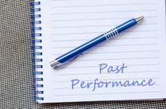 Past performance write on notebook - stock photo