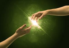 Touching arms lighting spark at fingertip - stock photo