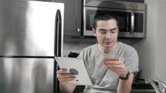 4K Online Shopping With Tablet In Kitchen Buying on Internet Stock Footage