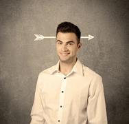 Young sales guy with arrow in the head - stock photo