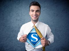 Businessman ripping off his shirt with superhero sign Stock Photos