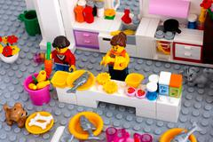 Lego scene. Cooking dinner on domestic kitchen. Stock Photos