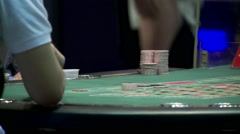 Roulette dealer placing marker on roulette table Stock Footage