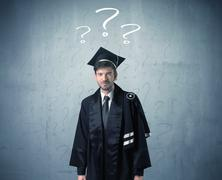 Young graduate teenager with question marks drawn - stock photo