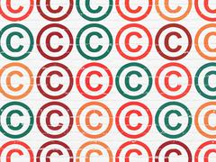 Law concept: Copyright icons on wall background Stock Illustration
