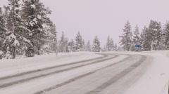 Heavy truck passes by the winter road in Saariselka, Finland. Stock Footage