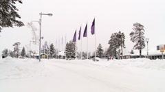 Car passes by the street of Saariselka, Finland. Stock Footage