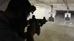 Man firing AR pistol Stock Footage