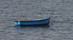 Boat moored in sea Stock Footage