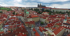 Flying through the old town of Prague, the Czech Republic towards the Cathedral Stock Footage