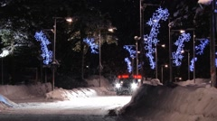 Car passes by the street with Christmas decorations in Saariselka, Finland. Stock Footage