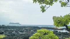 Natural Shores of Kailua Kona Hawaii with Cruise Ship in Background Stock Footage