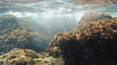 Waves breaking on the rocks - Underwater Stock Footage