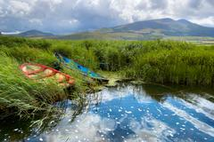 Fishing boats in a lake in County Kerry, Ireland - stock photo