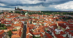 Flying through the old town of Prague, Czech Republic on a sunny day with clouds Stock Footage