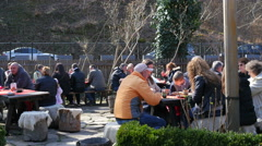 Tourists people eating in a street tavern in Etar Bulgaria Stock Footage