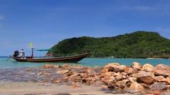 Koh Phangan. Long tail boat on Mae Head Beach. Stock Footage
