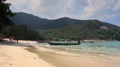Koh Phangan. Long tail boat on Bottle beach. Stock Footage