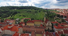Flying through the center of old Prague, Czech Republic towards Petrin garden. Stock Footage